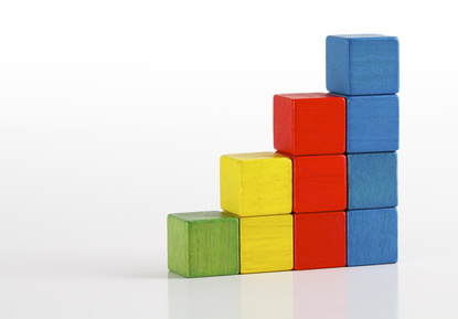 Toys blocks as step stair, multicolor wooden ladder building bricks over white background